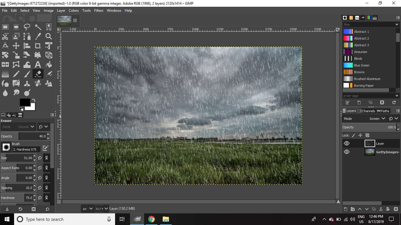 Brush a few areas of the fake rain layer to lend a more varied and naturalistic intensity to the effect.