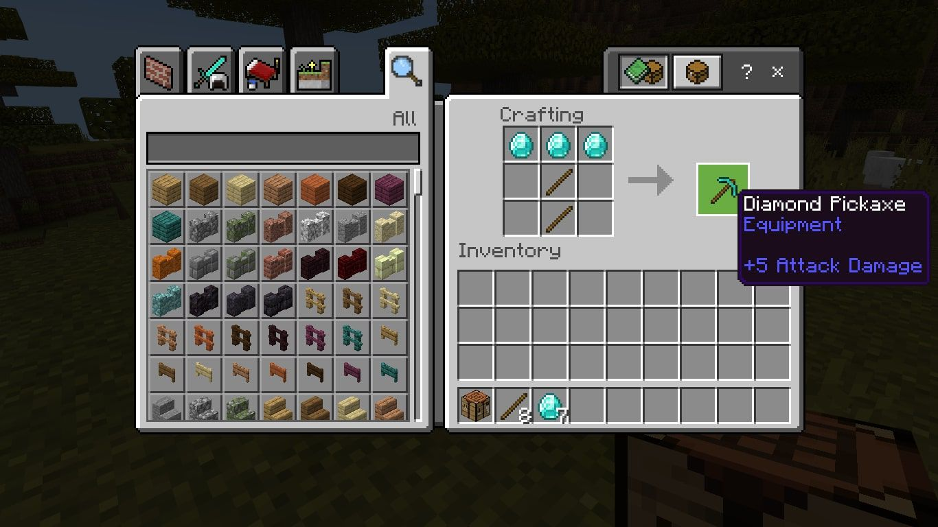 Craft a diamond pickaxe by placing three diamonds in the top row, then place sticks in the middle of the second and third rows.