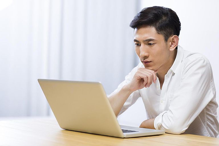 Man using Apple laptop