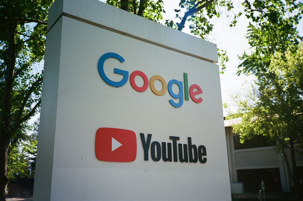 Sign with logos for Google and the Google owned video streaming service YouTube at the Googleplex.