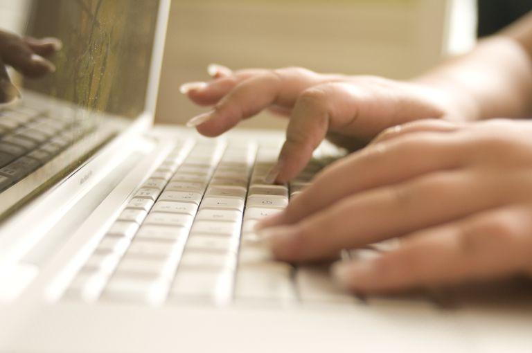Woman using keyboard, editing photos