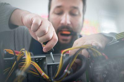 Man installing Hauppauge tuner card