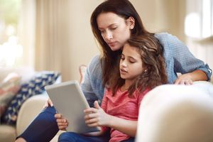 mom and child looking at ipad tablet together