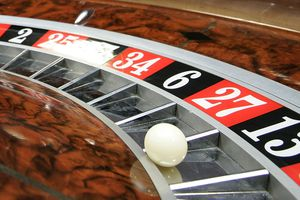 Roulette wheel closeup showing ball on lucky 13