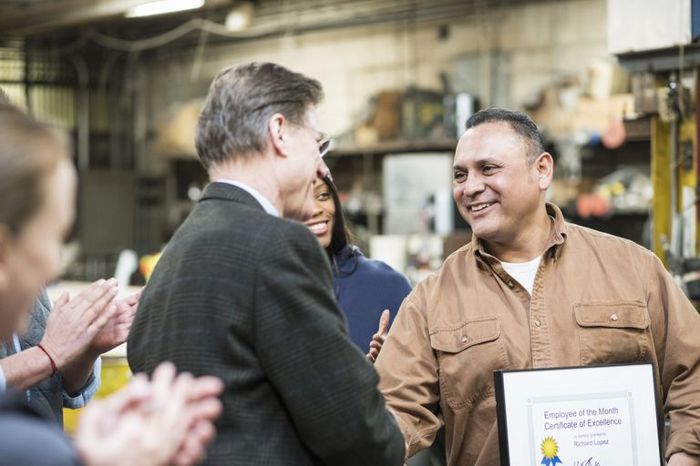 Worker receiving award in workshop
