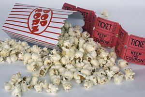 Spilled popcorn and movie tickets