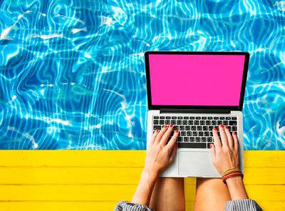 MacBook by the pool