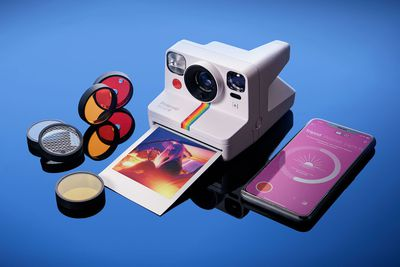 The Polaroid Now+ Camera and filters with the app showing on a smartphone.