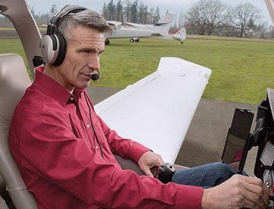 Man in small plane's cockpit with aviation headset