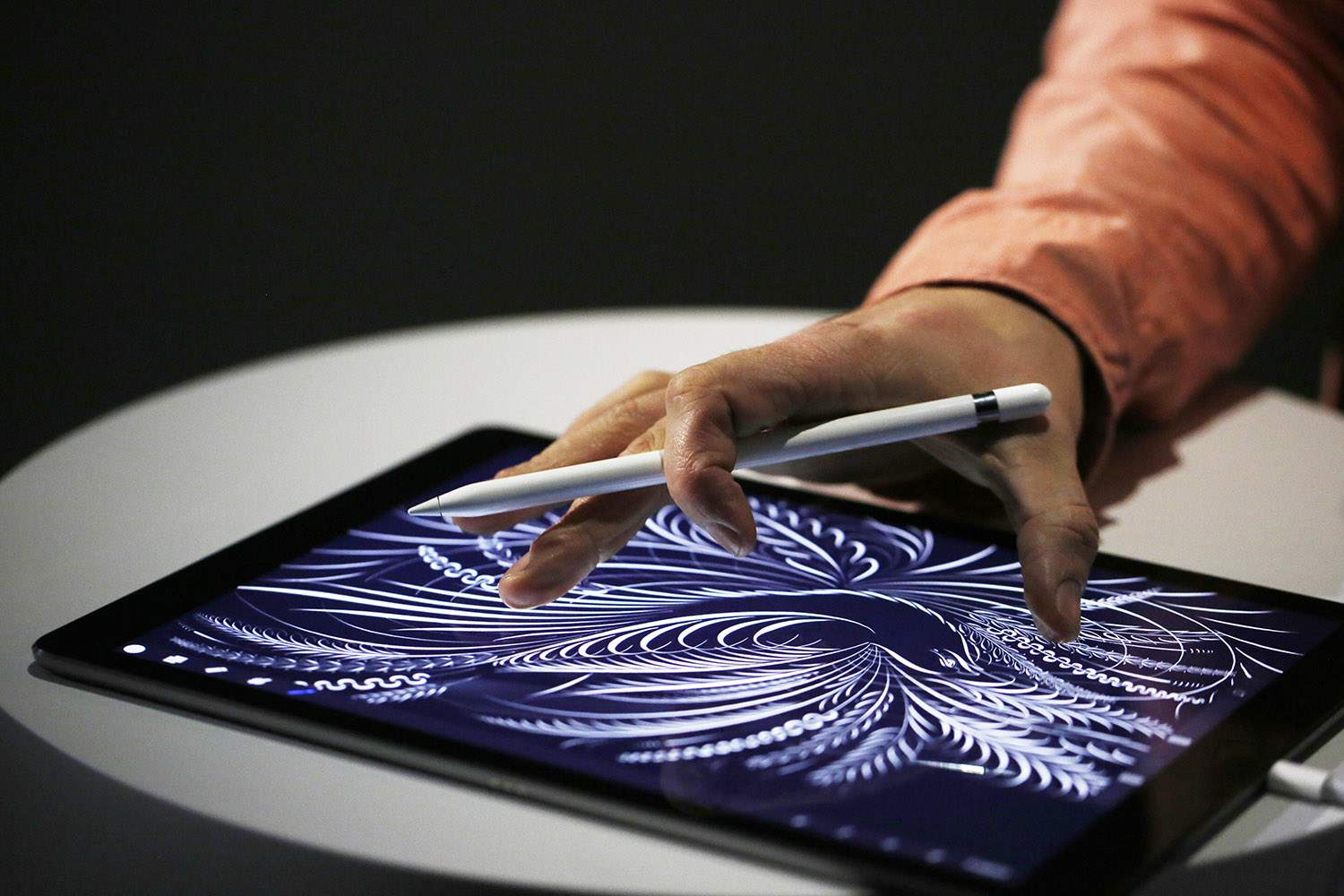 Using the new Apple Pencil on an iPad Pro after an Apple special event at Bill Graham Civic Auditorium September 9, 2015
