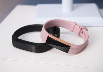 Two Fitbit Alta HR devices on a table.