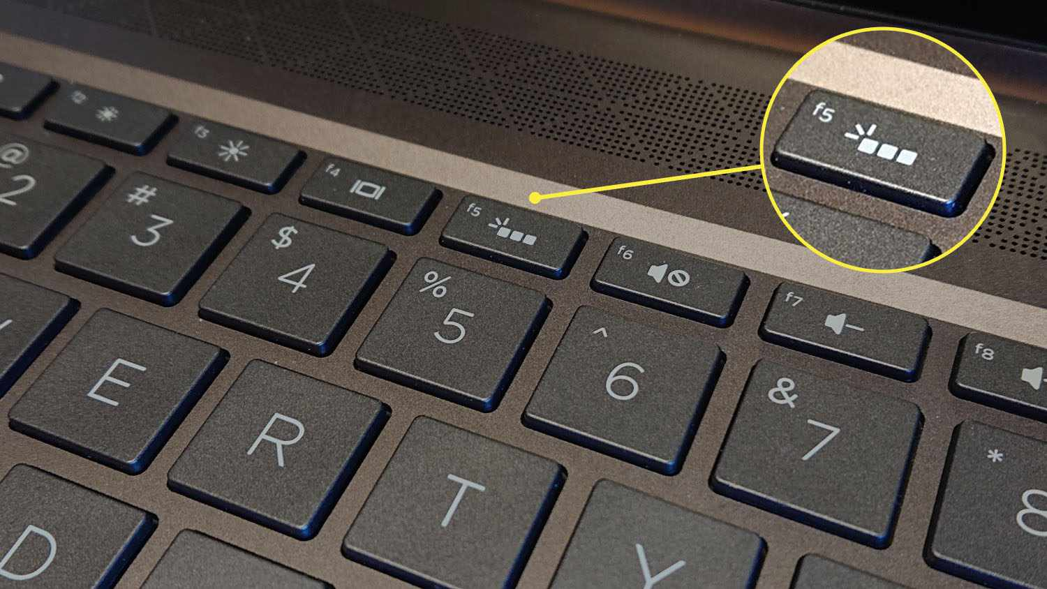 Keyboard backlighting key highlighted on an HP Spectre x360 13.