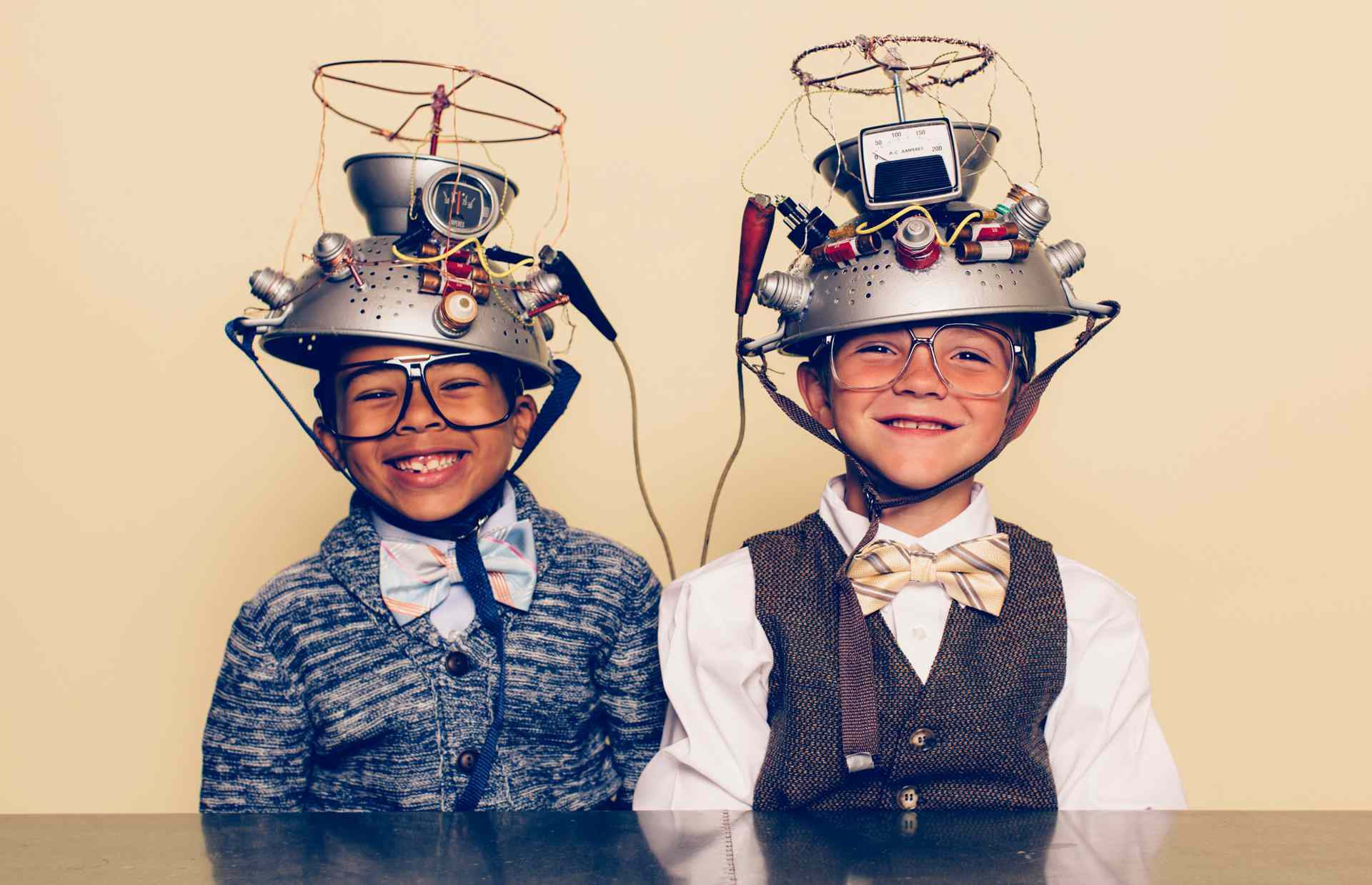 Two boys with time travel head gear toys.