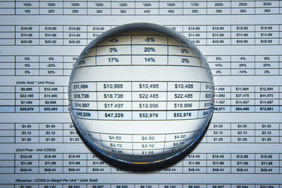 Image of a search glass over a spreadsheet