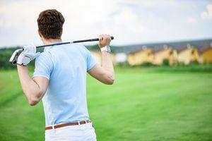 Golfer wearing smart watch on golf course