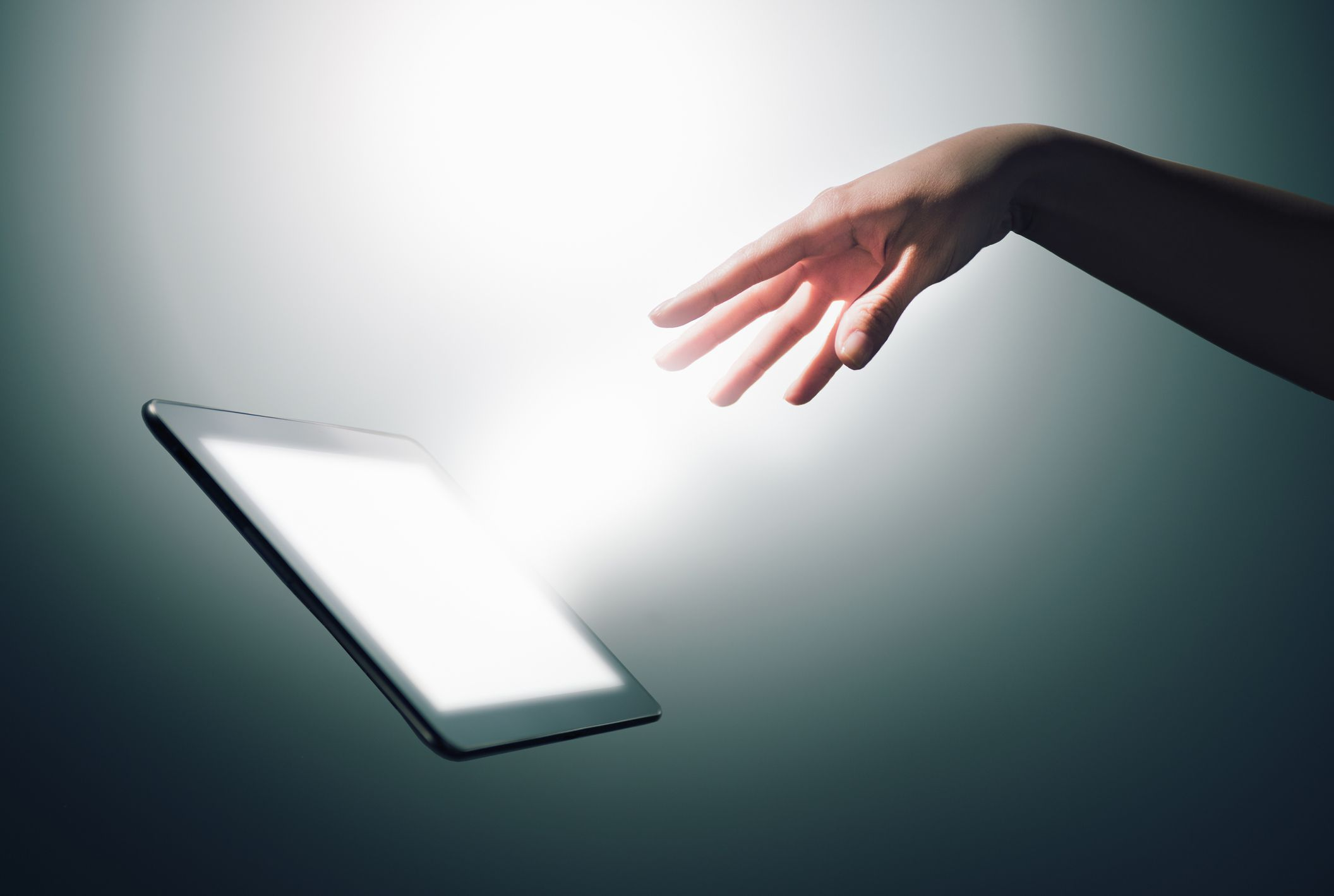 A hand commanding a digital tablet.