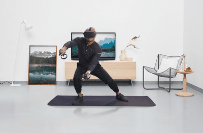 Person playing Supernatural's VR fitness game on Oculus in a living room