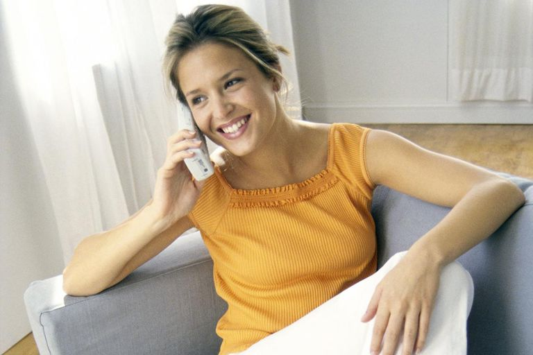 Young Woman Using Cordless Phone