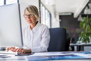 Businesswoman using desktop computer in office