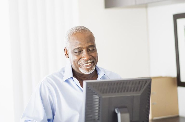 Portrait of senior man working on computer in office