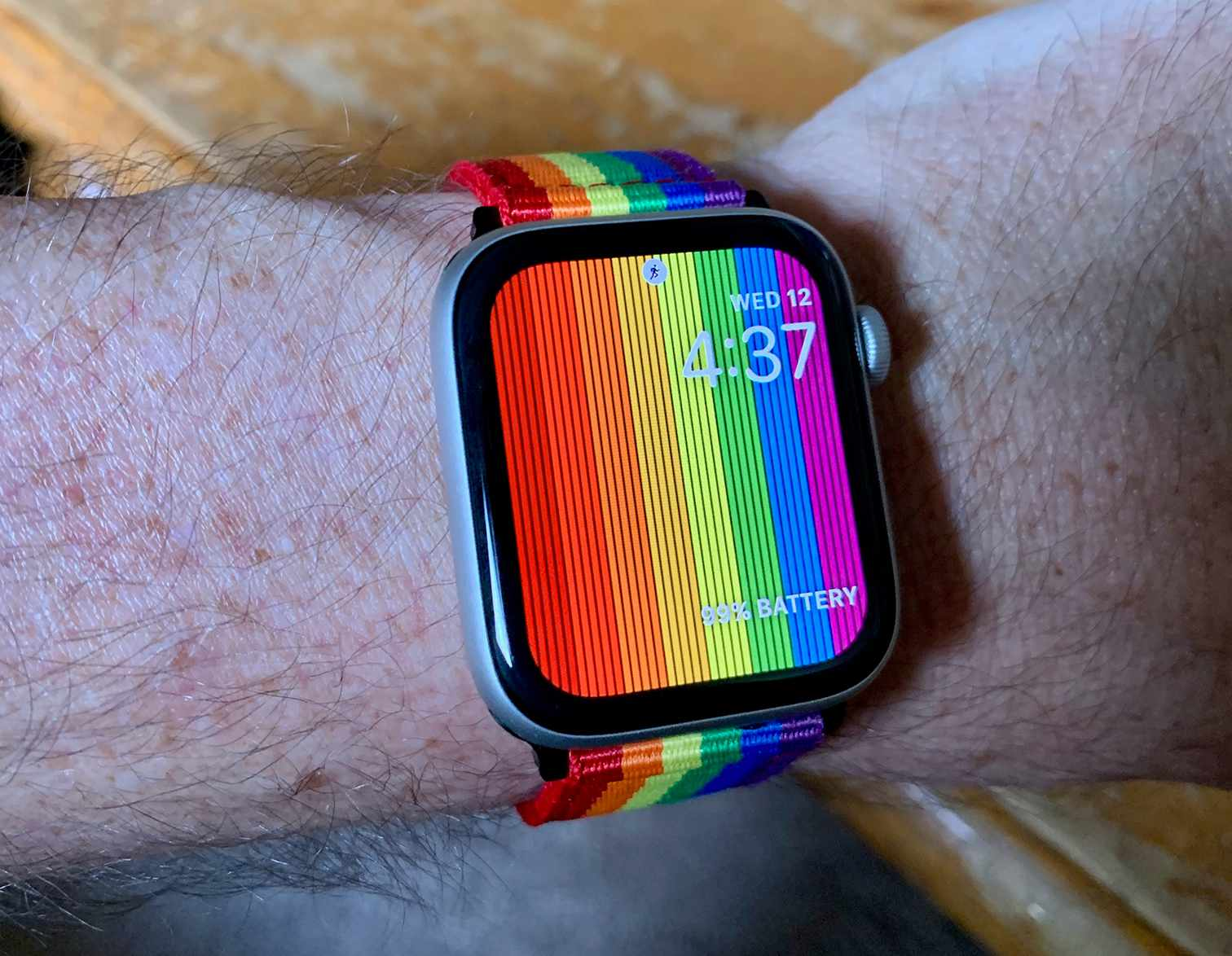 Apple Watch with Pride rainbow band and watch face