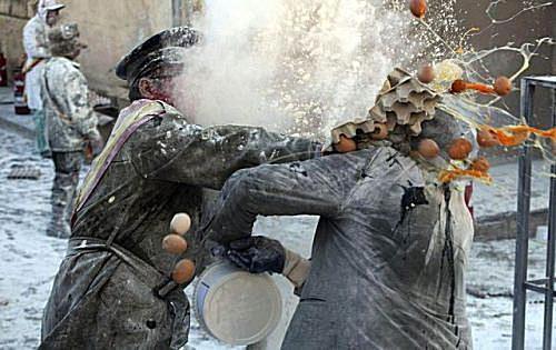Photo of soldier smashing eggs into another person's face