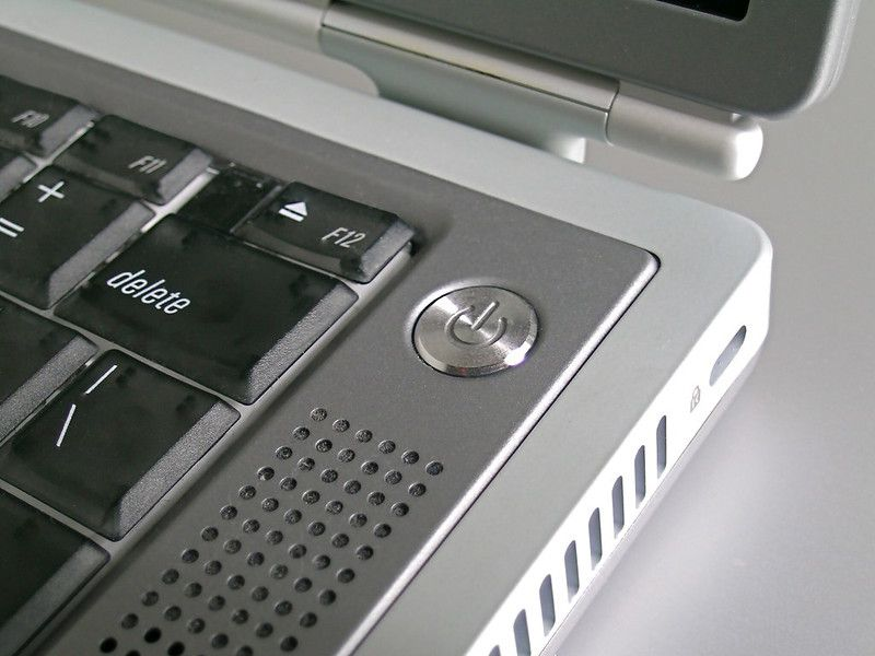 Close-up on the power button of a PowerBook G4 Titanium.