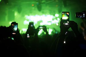Group of people taking video at music concert