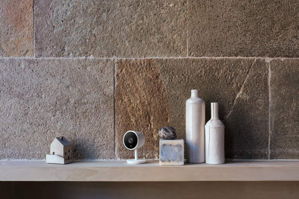 Nest Cam Indoor camera shown sitting on a mantle.