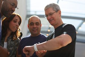 friends looking at an apple watch