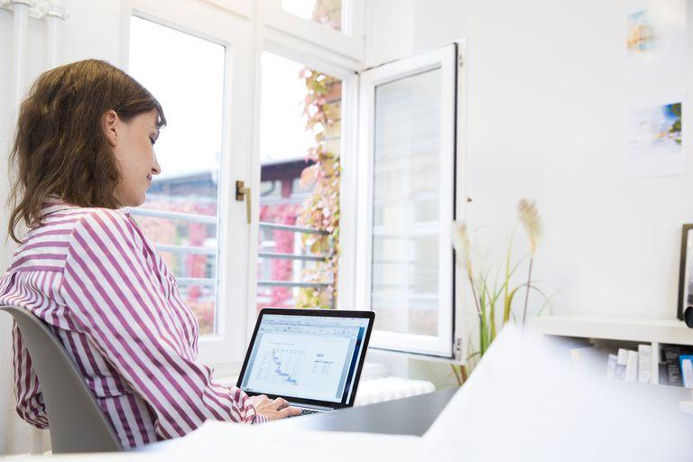 Woman using laptop in office