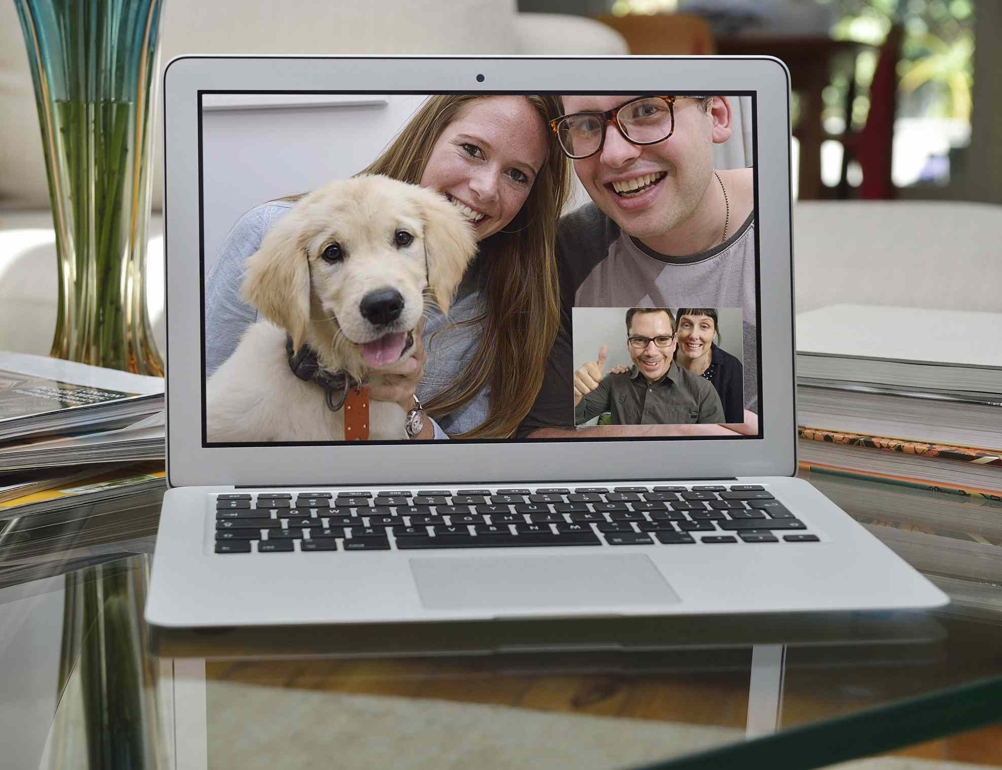 Couple showing off a new puppy over Skype free video chat service