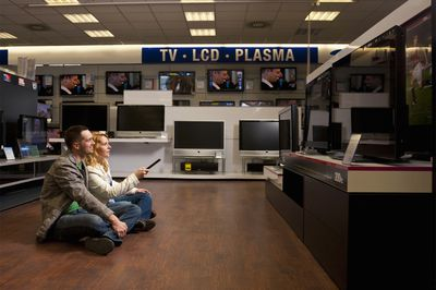 Young Couple Checking TV - LCD vs Plasma