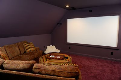 A projector used with a soundbar for sound.
