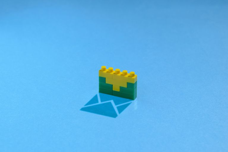 Plastic building blocks making an email shadow