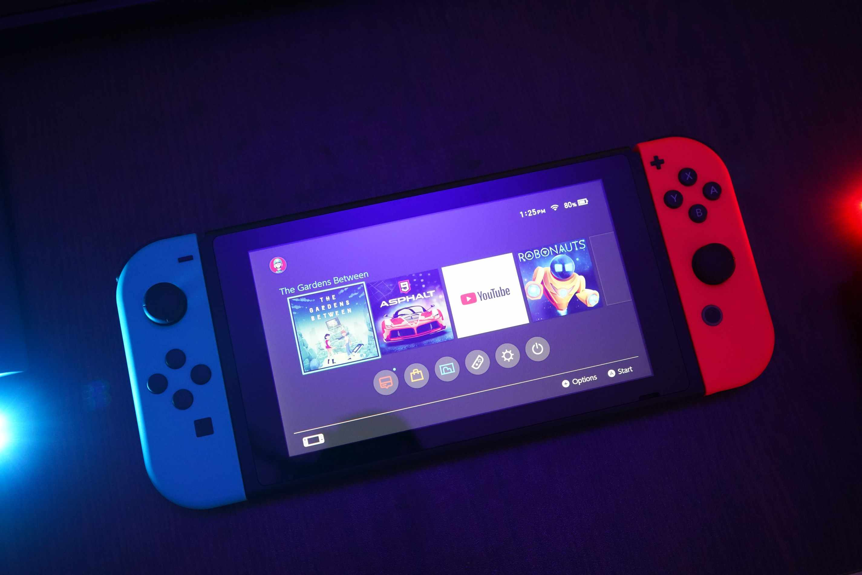 Nintendo Switch with The Gardens Between, YouTube, and other games on it