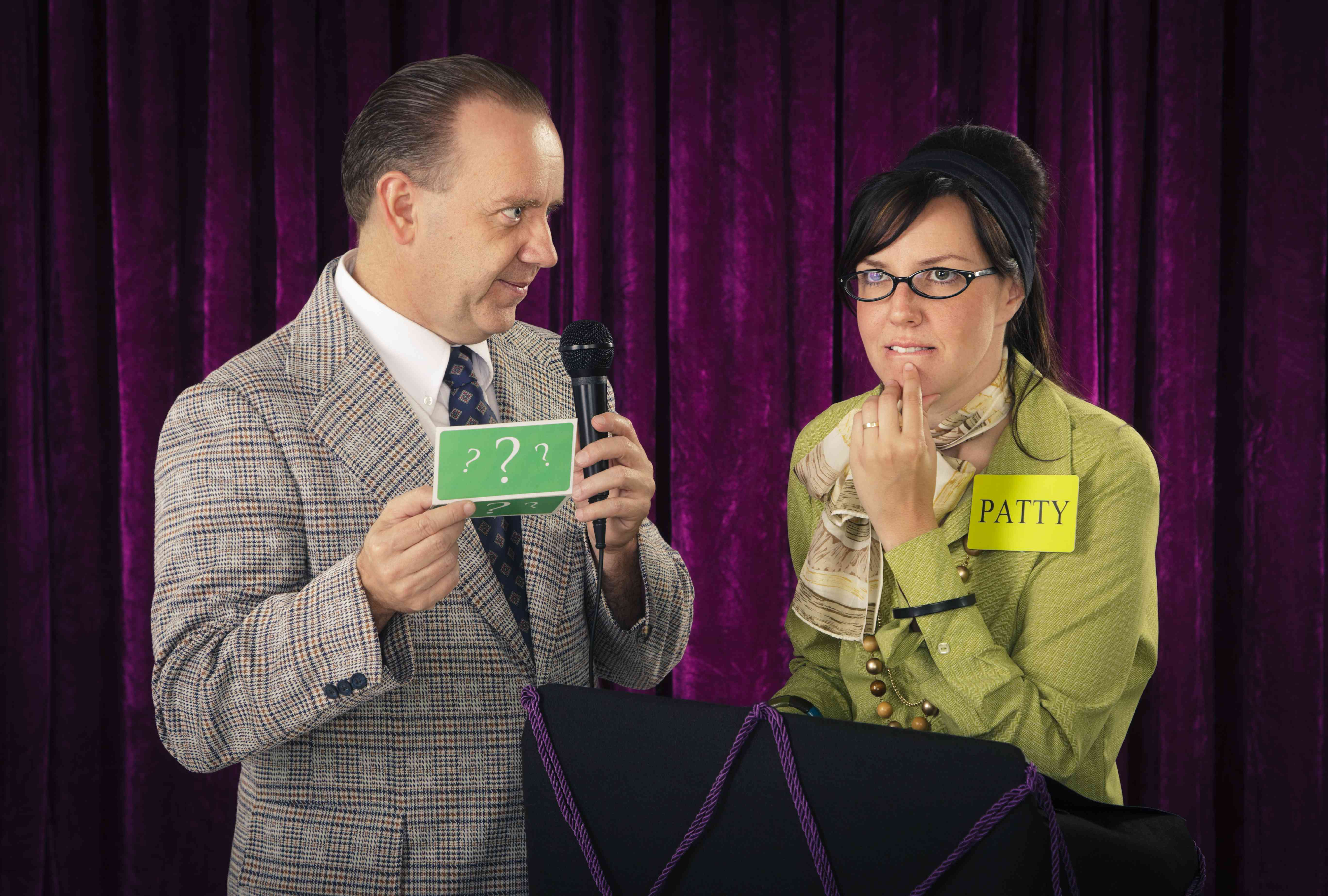 A host and contestant on a mock game show.
