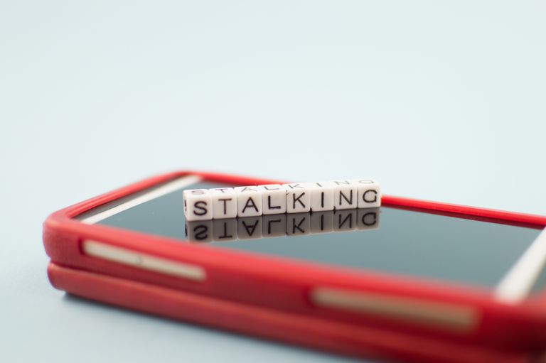 Mobile phone with the word stalking on it spelled in block letters