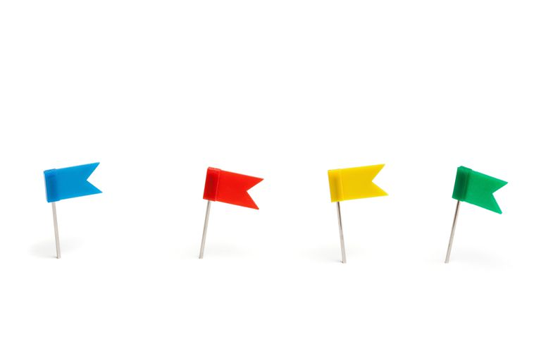 Close-Up Of Colorful Flag Shape Thumbtacks, depicting different color flags in Apple Mail