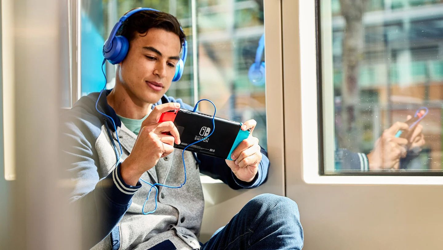 Person using a Switch with wired headphones