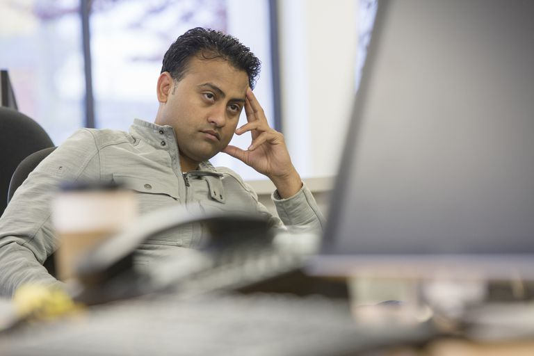 Frustrated man in front of computer