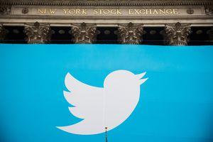 Twitter bird logo outside wall street