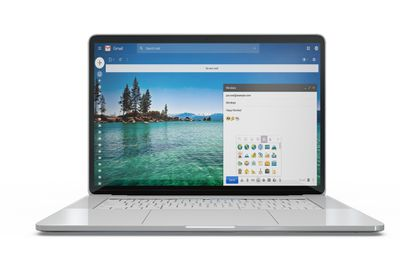 Laptop with Gmail-style emoticons onscreen in a new message