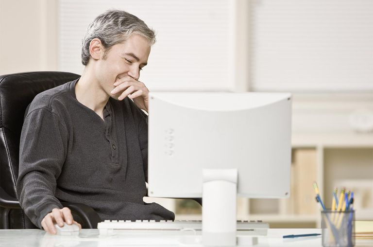 Man sitting at desk using computer
