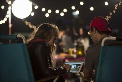 People looking at tablet