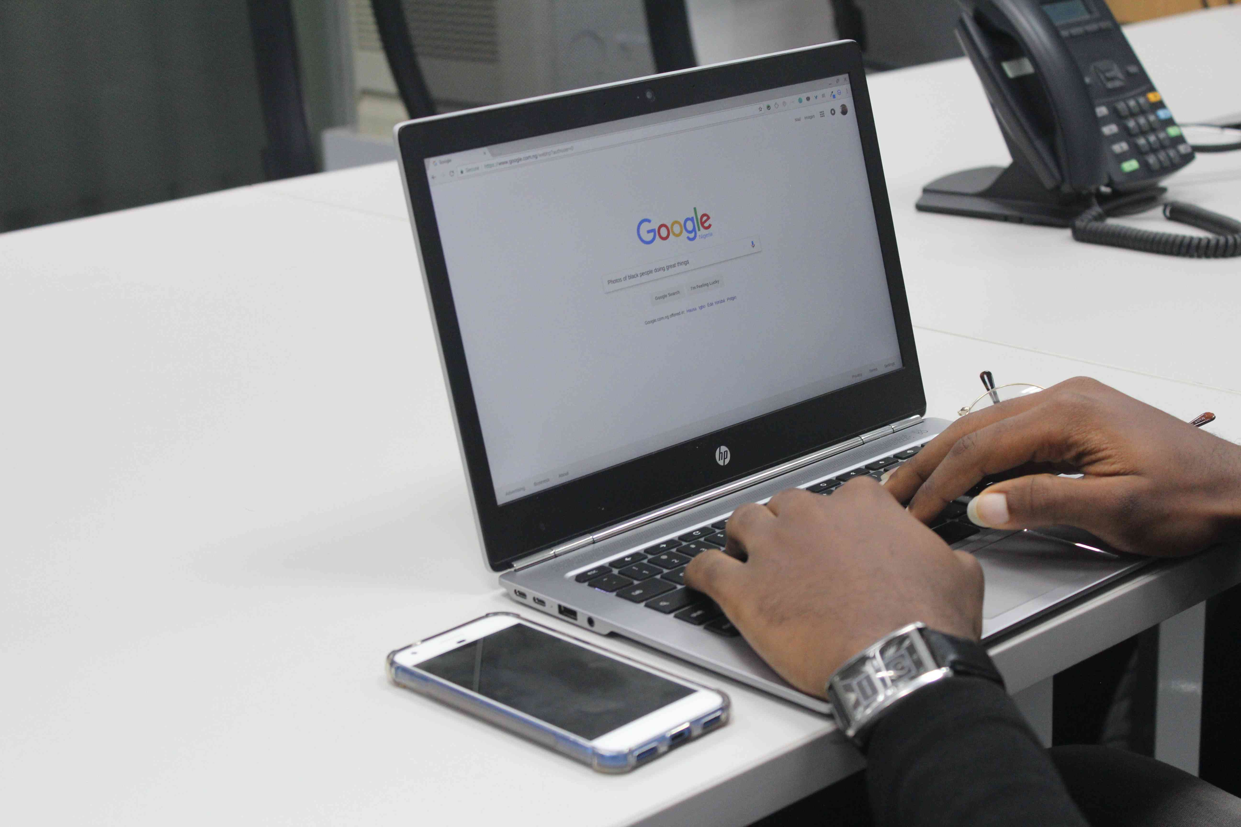 An image of the Google search page on a laptop.