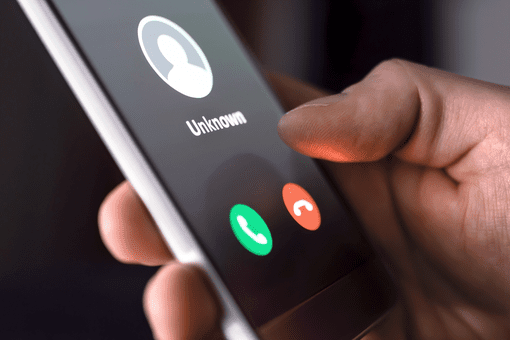 Image of an unwanted caller on a mobile phone