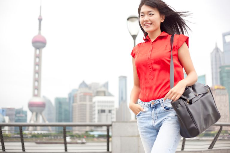 Young businesswoman, walking, outdoors, Shanghai, China
