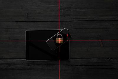 Locked smartphone on digital tablet