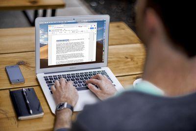 Man using Google Docs on his MacBook Air